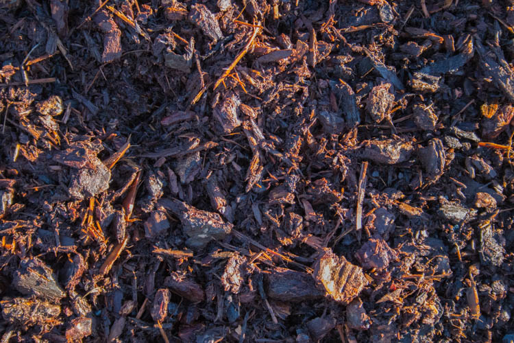 Classic Northwest garden bark. Mix of medium and fine ground bark with a coppery brown color. No added nutrients, used primarily as a natural weed inhibitor and ground cover.